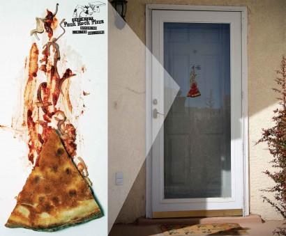 Door cling advertisement that looks like a piece of pizza was stuck to the door.