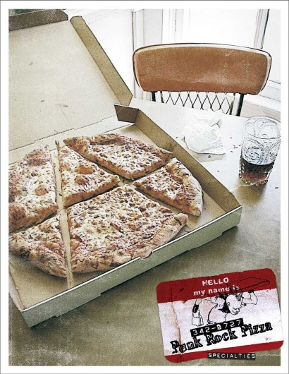 Anarchy symbol cut out of the pizza